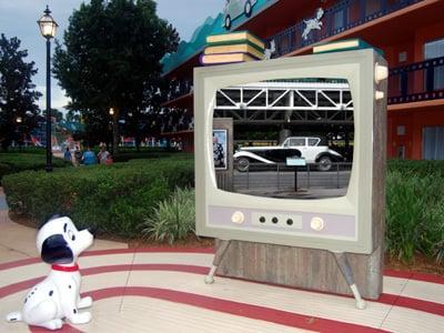 A Dalmatian watching TV