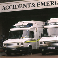 Two ambulances outside an Accident and Emergency department.