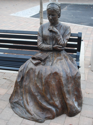 Charlotte Yonge on a Park Bench by Bluebottle