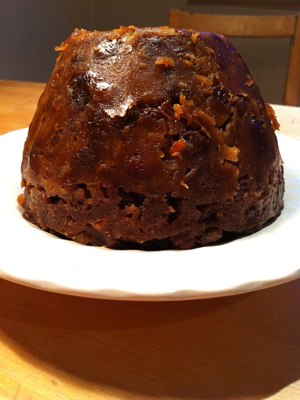 A picture of a Christmas pudding on a plate
