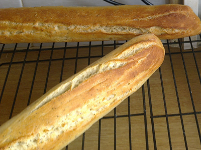 Baguettes cooling on a tray.