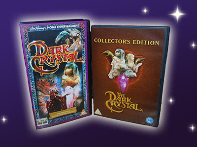 A photograph of a VHS and DVD cover of the Dark Crystal Film.