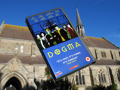 Dogma VHS in front of a church