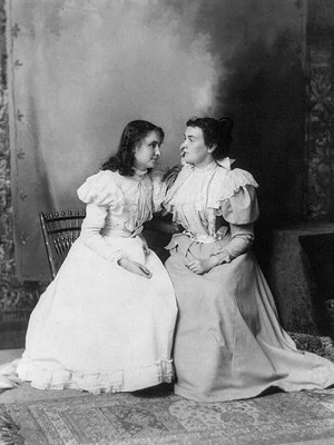 Helen Keller and Anne Sullivan.