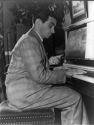 Irving Berlin playing the black keys on a piano