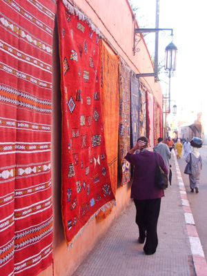 Moroccan carpets hanging for sale in a street in Marrakech.