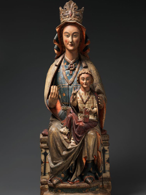 A medieval wooden statue of Mary and Jesus