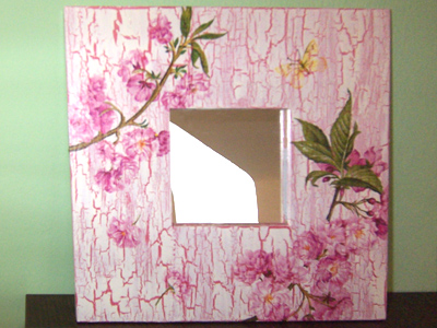 A mirror decorated with paper napkins.