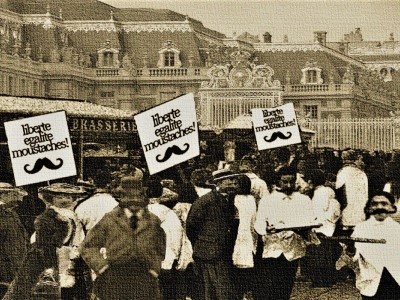 Waiters with signs saying 'Liberte, Egalite, Moustaches!'
