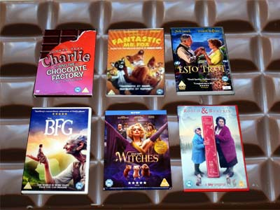 DVDs in front of a bar of chocolate
