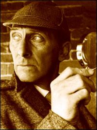 Peter Cushing as Sherlock Holmes.