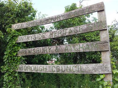 A wooden signpost along the Shrewsbury to Uffington canal walk.