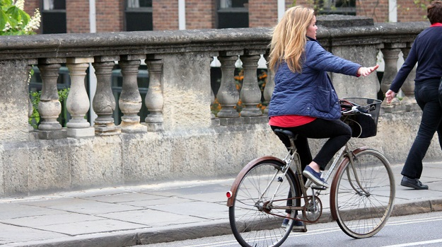 Urban cyclist, credit Tejvanphotos.