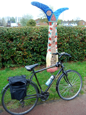 A bicycle in Basingstoke's Eastrop Park next to the rather unusual National Cycle Route 23 sign