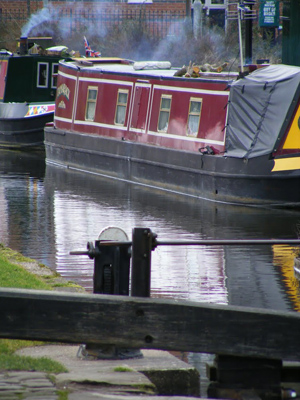 A narrow boat in a canal in winter