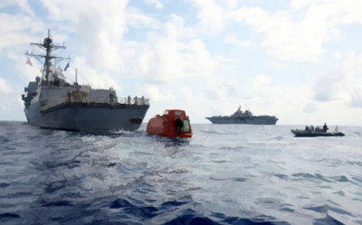 USS Bainbridge tows the lifeboat from the Maersk Alabama after Somali pirate attack, 14 Apr 2009.