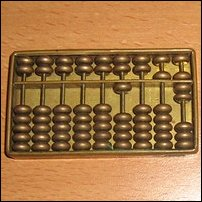 An abacus reading 1,057.