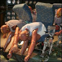 Some crash test dummies trying to survive a theoretical plane crash.