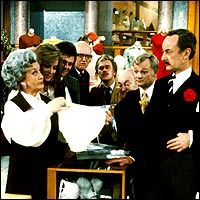 Mrs Slocombe shows Captain Peacock her knickers whilst the other members of the Grace Brothers staff look on, amazed.