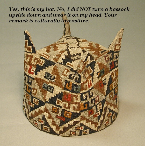 This is a rare hat from Peru. It has four horns. It looks like a hassock turned upside down. But it isn't.'