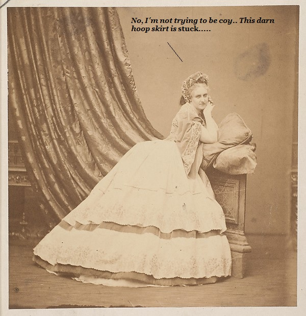Lady whose hoop skirt is caught in the curtains.