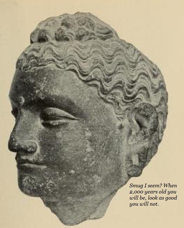 A smug-looking Buddha statue.