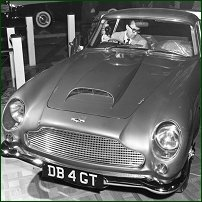 Luigi Grosso inspecting an Aston Martin DB 4 Coupe GT at the 1960 London Motor Show.