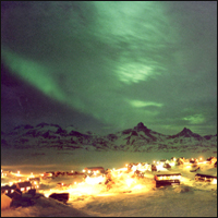 Aurora (Northern Lights) over Ammassalik skyline, East Greenland.