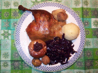 A plate showing an Austrian Christmas meal, with roast goose and vegetables.