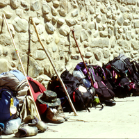 A queue of backpacks outside a Spanish hostel