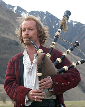 Actor Iain Glen playing the bagpipes in the CBBC TV adaptation of Robert Louis Stevenson's 'Kidnapped'