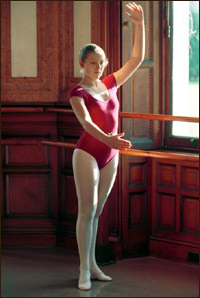 A young girl practicing ballet.