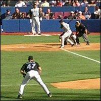 A baseballer in mid-swing.