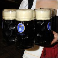 German beer being served at the<br/> Hofbraeukeller Beer Garden.