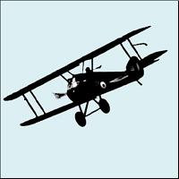A vintage aeroplane in silhouette.