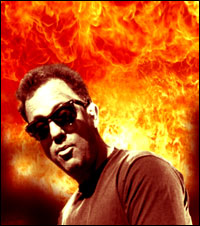 Singer-songwriter Billy Joel performs the song 'We Didn't Start the Fire' against a backdrop of flames.