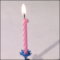 A single birthday candle.