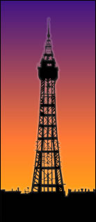 The Blackpool Tower at night, silhouetted against the glow of the town below.