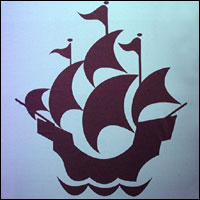 Stylised sailing ship - the Blue Peter emblem.