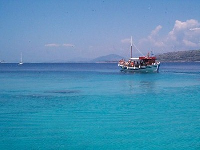 A boat on the blue Aegean Sea.