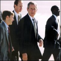 Bodyguards surrounding President George W Bush at RAF Brize Norton.