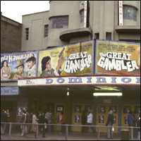 The streets of Southall, in the borough of Ealing, London, 12th June 1979. Seen here is the Dominion Cinema, showing a selection of Asian films including The Great Gambler and Janta Hawaldar.