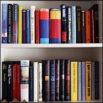 Various books on white shelves.