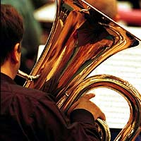 A tuba player in an orchestra.
