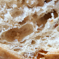 A close-up of the edge of a crust of bread