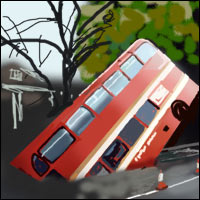 A red double-decker bus tips into a hole in the road.