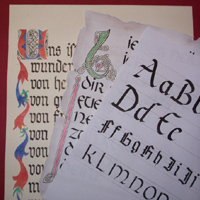 Sheets of paper with different examples of calligraphy through the ages.