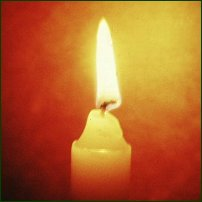 A candle, as used in the religious ceremonies of many different faiths.