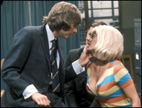 Eric Idle molests regular contributor Carol Cleveland, while Michael Palin looks on.