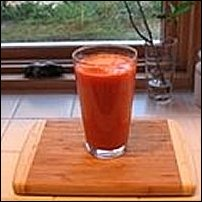 A glass of carrot juice.